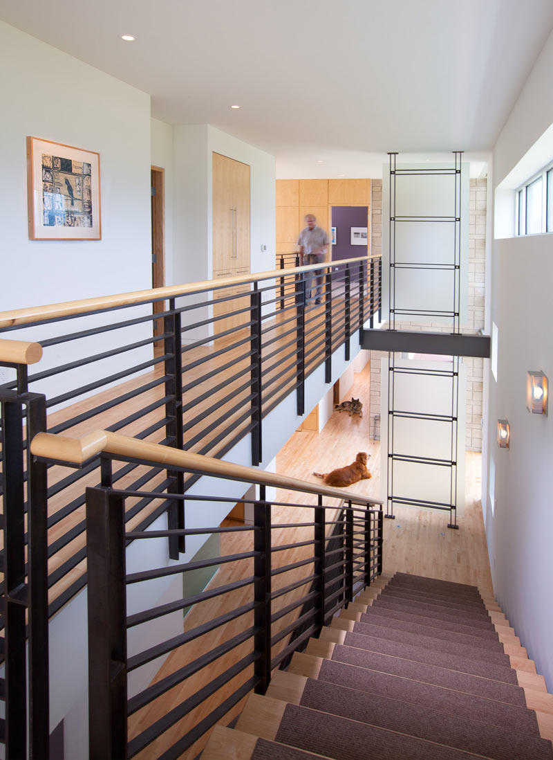 The exposed steel stair railing ties in the steel present in other ...