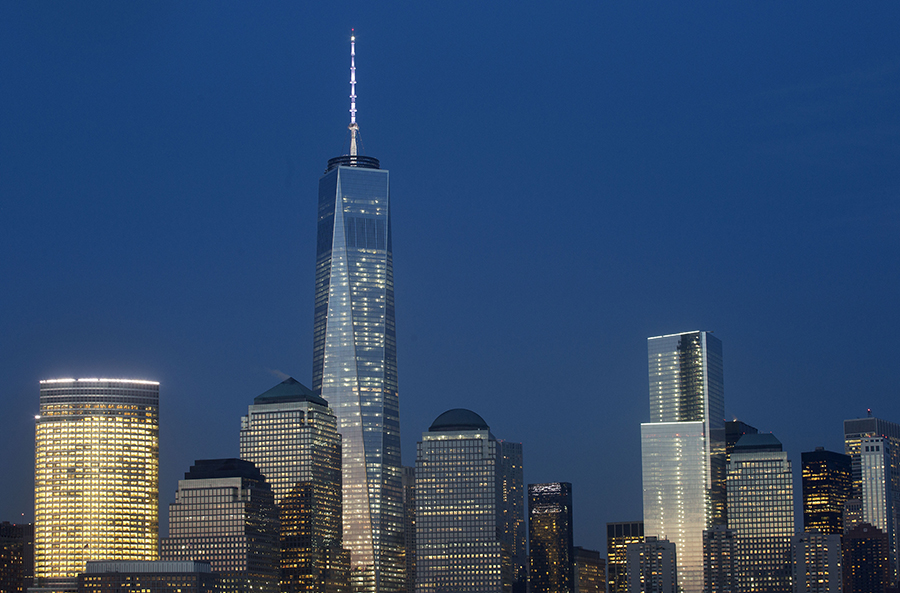 """Goldman Sachs headquarters, left, One World Trade Center, second left, and 4 World Trade Center, center, stand above the lower Manhattan skyline, Wednesday, April 2, 2014 in New York. About 700 people will race up 72 floors at 4 World Trade Center, Thursday in an event called the """"Runyon Up,"""" organized by the Damon Runyon Cancer Research Foundation. (AP Photo/Mark Lennihan)"""